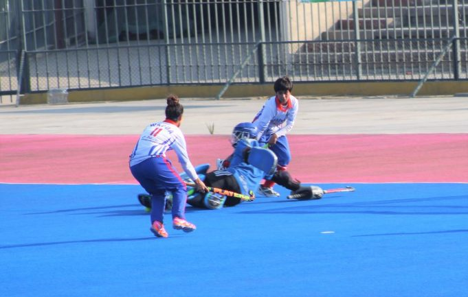 Punjab Colours goal keeper trying to thwart WAPDA attempt